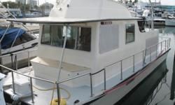 This is a 1984 Holiday Mansion hull but from ground up was rebuilt custom by the owner in 2005. 1. 35 Feet length, 11 Feet 11 Inch beam 2. Two Bravo II outdrives turning counter-rotating three blade props, 18.25X15 3. Two MerCruiser 160 hp 636D-TA inline