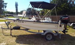 2005 Boston Whaler 130 Bay Sport, Stored indoors looks & runs like new, 130 Bay Sport, With 40 HP Mercury four stroke motor, dolfin, SS Prop, fuel water separator, bimini top, battery charger, rod holders, pedestal seat, bow filler cushion, rear bench