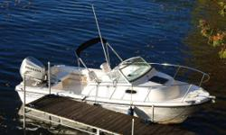 NEW LISTING! Very clean and well maintained 2005 Boston Whaler 205 Eastport. Single owner, exclusive freshwater use. Honda engine (200 HP Fourstroke) re-powered in 2010. Walkaround cuddy cabin, sleeps 2 adults comfortably. Open cockpit layout ideal for