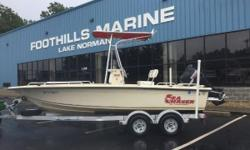 2005 Carolina Skiff Sea Chaser 1950 19' Carolina Skiff Sea Chaser 1950 With A Suzuki 140 4 Stroke Suzuki 140 4 Stroke Tandem Axle EZ Loader Trailer Lowrance Elite 5 Depth Finder VHF Radio Dual Batteries T-Top with Red Canvas Spare Tire Swim Platform
