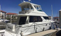 """""""SHORE BREAK V"""" is an Immaculate, Professionally Maintained 45 Voyager with only 400 Original Hours on her Twin Volvo Diesels.  Loaded with Upgrades Including: Flybridge Hard Top + Flybridge A/C, Bow & Stern Thrusters, Handheld Yacht"""