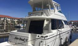 'SHORE BREAK V' is an Immaculate, Professionally Maintained 45 Voyager with only 400 Original Hours on her Twin Volvo Diesels. Loaded with Upgrades Including: Flybridge Hard Top + Flybridge A/C, Bow & Stern Thrusters, Handheld Yacht Controller, Davit for