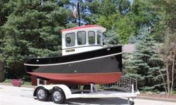 This unique 16/ft Custom Tug is here at our yard, and available for viewing. Commissioned and built by a world renowned naval architect / engineer in 2005, in Southeast MI on beautiful pristine fresh water lake St. Clair. This tug is #003 of 3 ever