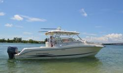 This 2005 Hydra Sport 33 VX Express has had several upgrades compared to other boats on the market. She has under 300 hours on the engines with all new exterior upholstery and eletronics. Her full custom boat cover keeps her protected from the sun. Owner