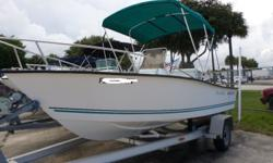 No trailer but one can be ordered for extra. Comes with some cg gear, bimini top, low hours, live well, compass, tach, speedo, cooler seat, and more. Free delivery to your local dock. Beam: 7 ft. 5 in. Fuel tank capacity: 35 Hull color: whtie Stock