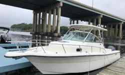 2005 Pursuit 2870 WA Walk Around powered with Twin Yamaha F225's.  Motors have approx 940 hours.  One motor has new powerhead, both have had exhausts/mid-sections serviced and replaced.  White hull with black anti-fouling bottom