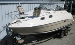 2005 Regal 2465 Commodore (26?11? X 8?6?), MerCruiser 5.0L MPI 260 HP B3, 2011 Trailmaster tandem axle Welded tube custom trailer with 4 wheel disc brakes, aluminum tread plates, Chrome mags, spare tire and Mount. This boat has two tone gelcoat in Desert