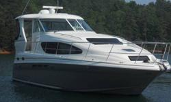 Fresh water Beauty! Spacious Helm wraparound seating and full wet bar. 2 state rooms (forward and aft) 2 - full heads with stand up showers lower aft stateroom has seperate head and shower. Salon features curved seating couch and dinette, upgraded step