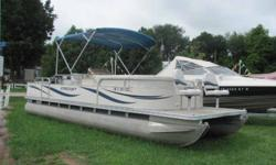 """This 24' Starcraft """"Classic 240 DLX 4-point"""" fishing pontoon is powered by a 60hp 4-stroke Mercury Big Foot. Includes swim ladder, fish finder, table, changing room, and a mooring cover. Beam: 8 ft. 0 in. Stock number: 9811"""