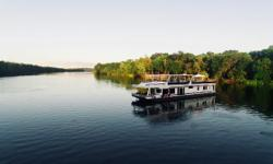 Sumerset Houseboat 90'x18' powered by Twin Mercruiser stern drives. Bow and Stern Thrusters for safety-maneuverability of the vessel i.e. Captains & novice boat handlers alike. She is a full length companion way vessel located starboard side with front