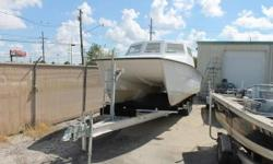 2005 Twin Vee 32 This 2005 32' Twin Vee was going to be the ultimate dive boat. The project lost steam and now needs to be finished by its buyer. All wood was taken out of the boat and replaced with Coosa. Custom pilot house built and live bait and kill