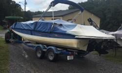 2006 Bayliner 217 Deckboat Mercruiser 4.3 MPI 220HP 2006 Karavan Tandem Axle Trailer $13,890. Very roomy one owner boat with professional maintenance since new. Loaded with Options: Bimini top, Stereo, Fiberglass Liner, Snap-in Carpet, Front and