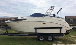This 2006 Bayliner 265 Sunbridge is loaded with options and includes a trailer.This beauty has NEVER BEEN IN SALT WATER!!!! She is powered by a Mercruiser 350 Mag MPI Bravo III and sits on a VIP tandem trailer. Owner states that she has less than