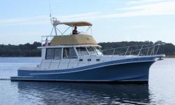 This Legare Fox Island 42 is a bullet-proof commercial fishing design, finely finished as a flybridge cruising yacht. Built in New Brunswick, Canada by Magna Marine, her hull is constructed to safely handle the toughest North Atlantic offshore