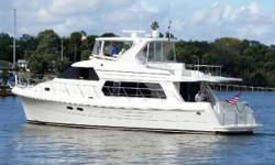 Luxurious Pilothouse Motor Yacht FEATURED IN FIRST CLASS CONDITION Sky Lounge w/Hardtop w/EZ2CY Acrylic Enclosure Air Conditioned Flybridge and Engine Room Fuel Efficient Cummins QSC 540 HP diesels Third Station Controls in Cockpit Bow and Stern