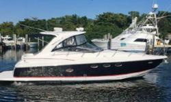 This boat is equipped with twin Mercruiser 8.1L HO FWC engines, Generator, custom two tone hull, cockpit cover, bow sunpad with cover, hardtop, oil change system, vacuflush heads, mid cabin tv, snap in carpet, anchor windlass, extended swim platform,