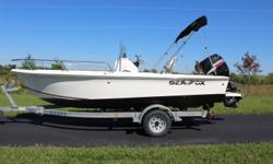 """2006 SeaFox 172 CC 17'1"""" White with front cooler, rear aerated livewell, bimini top with boot, front storage with cushions, built on rear ladder, super nice shape inside and out. Suzuki 90hp 4 stroke EFI motor, completely serviced by our Marine tech with"""