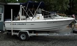 17 Ft Center Console, 2006 90 HP Yamaha 2 Stroke 90TLR, Bimini top, Garmin 178C GPS/Fish Finder, Stereo CD Player, Cooler Seat with Swing Backrest, Cooler Seat Front of Console, 2005 Wesco Aluminum Trailer, Above Average Condition Beam: 7 ft. 5 in. Depth