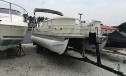 The Sun Tracker Party Barge 22 Regency Edition is our most compact and towable luxury pontoon (trailer optional). Abundant creature comforts include extra-wide padded aft sundeck with pop-up changing room and bench, plush lounge seating with in-arm and