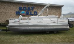 2006 Sylvan Sun Chaser 20' Pontoon & 40HP Evinrude E-TEC Outboard. Motor Runs Great! This Pontoon Features, Two Front Swivel Fishing Seats, Seating In Front Of Helm, Including A Live Well, Bench Seating With Storage, Sun Deck With Changing Station, Two