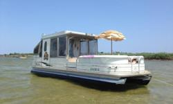 Have some family fun on this 30 foot pontoon. Hard covered with lounge area roof Small kitchen set up changing room 2016 mercury 150 xl stop by our Marina or give us a call Nominal Length: 31' Length Overall: 31' Engine(s): Fuel Type: Other Engine Type: