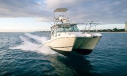 """$10k Price Reduction: """"Mad House"""" is one of only two World Cat 320 EC currently for sale in the US. Her single owner is preparing to take delivery of a new build and does not want to be a two-boat-owner. She is loaded with options and ready to be"""
