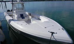 Description Pop-up cleatsOutriggersIn deck live wellStand up headNew Cushions Electronics Two Northstar 6100iVHFTR1 autopilotExcellent sound systemElectric windlass Engines Triple 275 Mercury Verados.Just Serviced (600 hrs.) Category: Powerboats Water