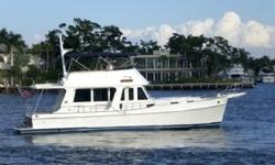47' Grand Banks Overview Grand Escape is professionally maintained in excellent condition with low hoursand docked inbrackish water under cover. Check out the incredible electronics list in this brochure. From her Flir night vision system to her ESI fuel