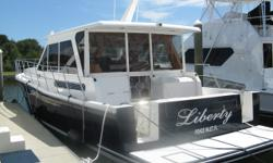 Description FOR FULL AND COMPLETE SPECIFICATIONS CLICK HERE Intoduction This is a Downeast style express yacht with quality construction and upscale accommodations. Rich two stateroom two-head interior with large galley and huge master stateroom. She has