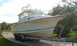(LOCATION: Tampa FL) The Baha 300 GLE is an express fisherman with large cockpit, enclosed helm, tuna tower and roomy cabin. Her 115 square foot cockpit has all the amenities needed for successful offshore fishing with a cabin for overnight and weekend