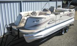 """2007 Crest Savannah LST 50th Anniversary I/O Tritoon (25' x 8'6""""), MerCruiser 350 Magnum MPI 300HP B3, 2013 Mid America tandem wide axle trailer with brakes. This boat is White with Gray and Rose graphics. The floorplan Has a double wide drivers seat with"""