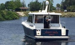 """New to Market :BOAT SHOW SPECIAL : $299,990 Big PRICE REDUCTION!! Extremely well laid-out two stateroom, two head Hardtop Express Cruiser. A very nice boat ready to go to new owner. Features include: 15'6"""" Beam common on 50'+ vessels 750 hours Separate"""