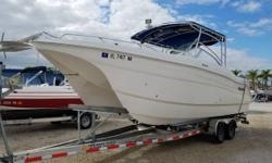 This Beauty Is Powered With Twin Suzuki 150 HP Outboard Motors That Have 425 Hours On Them. Equipped With Garmin 540S, VHF Radio, Windlass, Oversize Dive Ladder, Large Soft Top And Electric Head. Trailer Not Included But One Is Available. Trailer Not
