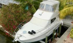 (LOCATION: Long Boat Key FL) The Silverton 33 Convertible is a mid-sized cruiser with big cruiser features. She has a flybridge with radar arch, open cockpit, roomy salon, and two private staterooms to insure comfort and convenience. With sleep sofa this