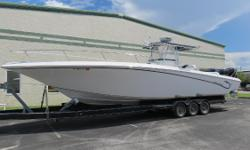 New to the market !!! Repowered in 2013 with new Mercury Verado's 300's with the larger gear cases.Compare against older powered models with smaller cases.Under 300 hours on the engines. Triple Mercury 300 Verado,Zero Effort Throttles(DTS),K-Planes,Dual
