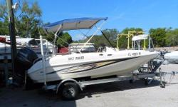 2008 Hurricane GS-172 Deck Boat with a Yamaha 115 HP and Magic Tilt trailer. 17', white in color with a navy bimini top. Motor: Yamaha 115HP (Model# F115HPTLR) Less than 500 Hours on motor Nominal Length: 17'