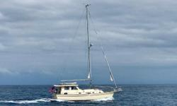 41' | Island Packet SP Cruiser Motorsailer | 2008 Beautiful Example of Island Packet Craftsmanship! This motorsailer island packet is the perfect yacht for both coastal cruising. The raised pilothouse makes it easy to operate the vessel while keeping warm