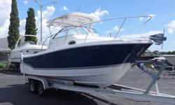 """""""30 of Fishing and Cruising Packed into 23. We introduced our first 23 cabin boat in 1978 and it was an instant success. And our modern day new 23 Express takes midsize family boating to a new level. With more seating, storage, fishboxes, and well thought"""