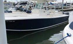2008 Regulator 26FS with Twin Yamaha F250 four-strokes with approx 300 hours.  Garmin 4212 with Radar, Icom VHF, stereo.  Powder coat, T-top with rocket launchers, aft seat, low bow grab rail.  Navy hull with black bottom paint.  No