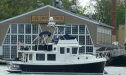 """Description Here it is! Absolutly the best 34 American Tug on the planet!! Very Rare Fly Bridge model with abimini top thatlowers to 14' 4"""" Beautiful Flag Blue Hull!! The Best Electronics!! Watermaker!! Oil Change System!! Bow Thrusterand Solar Panels!!"""