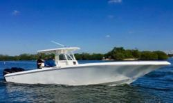 RE-POWERED (April 2017) with brand new 2017 Triple Mercury Verado 400HP Racing Series Outboards on hydraulic jack plates (with a transferable 5 Year extended warranty). 2009 MYCO Aluminum Triple Axle Custom Trailer included in sale!  The last model