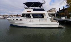 Certified Trade with Warranty - 41' Grand Banks Heritage EU 2009 with many upgrades, including a spacious Fly Bridge, custom bedding, refinished varnish 2018, ABT-Trac Stablizers and more. The beautifully finished interior is open, comfortable and ready