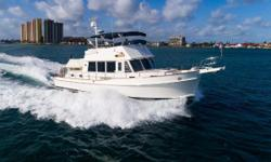 """Truly in Exceptional Condition, Turn Key and Ready for Her New Owner! 2 X Cummins QSC 8.3 550 HP - 1,000 hour service completed Side-Power Bow Thruster Full Beam Master 2 X Garmin 5212 12"""" GPS Touchscreen (One on Lower Helm and One on Fly) 2 X Furuno"""