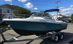 2009 SEA HUNT DUAL CONSOLE Beautiful 2009 20' Sea Hunt Dual Console. Powered by a Yamaha 2007. Comes complete with head, GPS, bluetooth radio with 4 speakers, 2 batteries, Bimini top, mooring cover, live well & wash down, fuel water separator, trim tabs