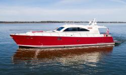 This Vicem 66 Sport Yacht was commissioned specifically for the owner, and no expense was spared in her design and construction.  She offers handcrafted custom cherry and mahogany inlaid furniture and joinery, with leather seating throughout the