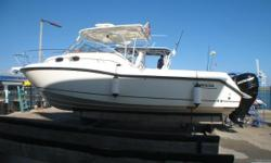 2010 Boston Whaler 305 Conquest located in Port Canaveral, FL. Thisexpress aft cabin bluewater fishing platformlooks like new as she has been kept in covered rack storage since new. Only 325 hours on the Verado 300's.