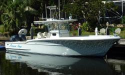 Time to Sell! Bring all offers! Will trade up to a quality 44-50' express cruiser.....Sea Ray, Tiara.....Price reduced 15K!2010 34' Buddy Davis Center Console -- Low Hours on Twin Yamaha 350's 400 hour service completed!One new Yamaha 350, the other had
