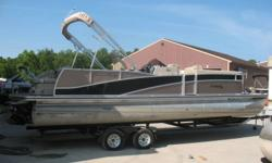 5.7 V-8 Mercruiser Nice and clean and in very good condition Pontoon. Features include Port side pit group, tow bar, rear facing lounge, ski locker in tube, table counsel with ice sink, depth finder, Alpine am fm sound system with sub woofer and amp,