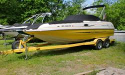 This is a one owner boat. It has not been let in the water when not in use. It is powered by a 5.7 liter MerCruiser with 300hp.It sits on a custom tandem axle E-Z Loader trailer with brakes. There is also a camper enclosure if you wanted to stay out over