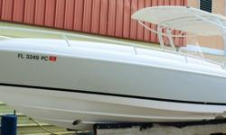 2011 INTREPID 323 CENTER CONSOLE W/FORWARD CABIN, hull color is Intrepid?s own Light Stone Grey Imron with Black Imron boot stripe (Imron paint will never fade, much more durable than gelcoat), twin Mercury Verado 300hp supercharged four strokes custom